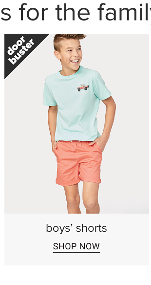 A boy in a aqua tee shirt with a graphic of a truck and coral shorts. Doorbuster. Boys shorts. Shop now.