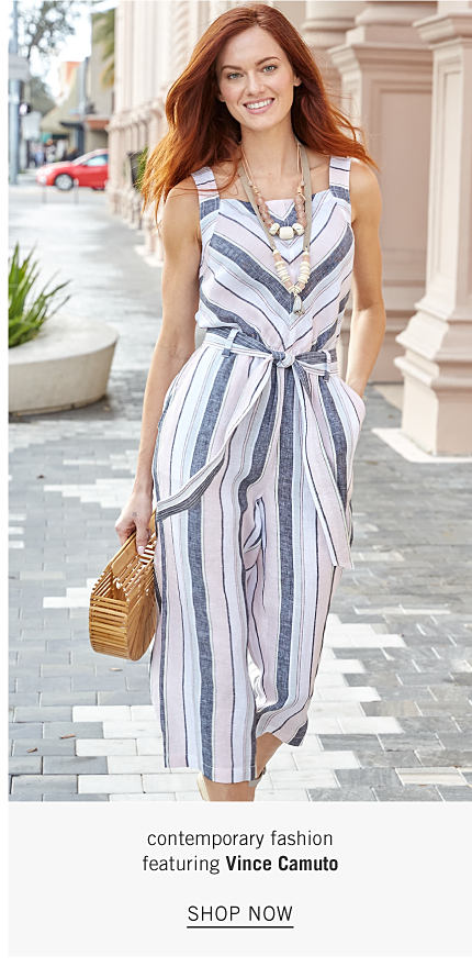 A woman wearing a multi colored vertical striped sleeveless romper carrying a bamboo handbag. Up to 25% off contemporary fashion featuring Vince Camuto. Shop now.
