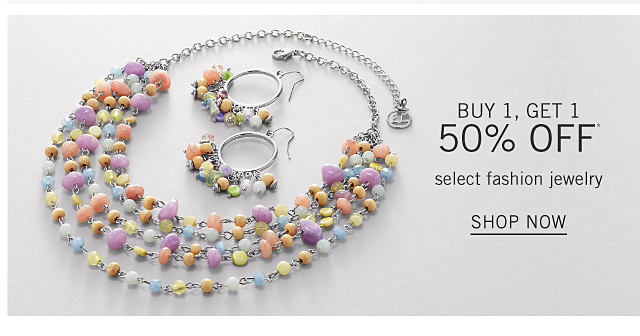 A silver tone & multi colored beaded multi row necklace & silver tone & multi colored beaded earrings. Buy 1, Get 1 50% off select fashion jewelry. Free or discounted items must be of equal or lesser value. Shop now.