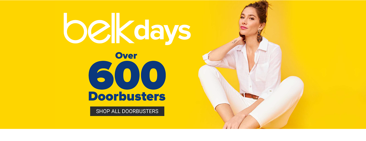 A woman in a white button down shirt, a brown belt and white pants. Belk days. Over 600 doorbusters. Shop all doorbusters.