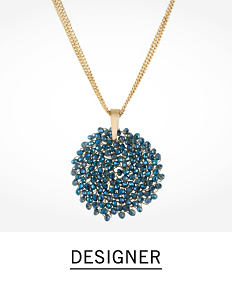 A gold tone necklace with a blue beaded pendant. Shop designer.