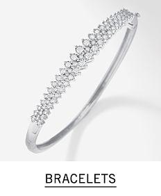 A silver & diamond bracelet. Shop bracelets.