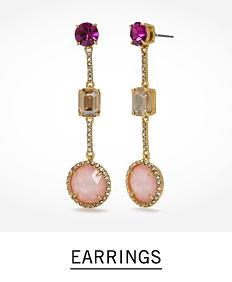 A pair of dangly fashion jewelry earrings. Shop earrings.