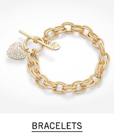 A gold tone chain bracelet. Shop bracelets.