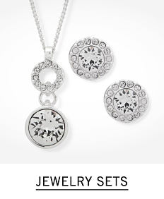 A silver tone pendant necklace & matching earrings. Shop jewelry sets.