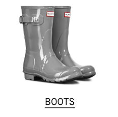 A pair of gray rain boots. Shop boots.