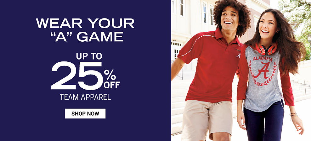 A young man wearing a red and white Alabama Crimson Tide polo and white shorts. A young woman wearing a red and gray Alabama Crimson Tide jersey and blue jeans. Wear Your A Game. Up to 25% off team apparel. Shop Now.