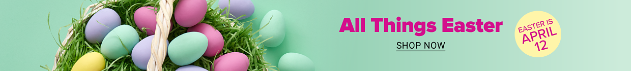 An easter basket with an assortment of eggs in pastel pink, green and purple on a bed of grass. All things Easter. Easter is April 12. Shop now.