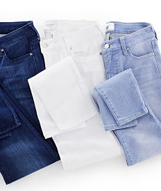 A pair of dark wash jeans, a pair of white jeans and a pair of light wash jeans. Shop jeans.