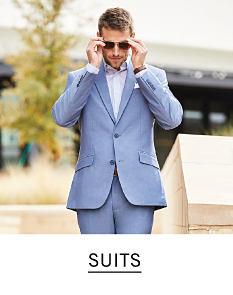 b5c04e619390 A man wearing a light blue suit   white dress shirt. Shop suits.