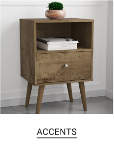 A small wood table. Accents.
