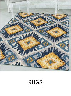 An area rug with a blue, yellow and white geometric pattern. Rugs.