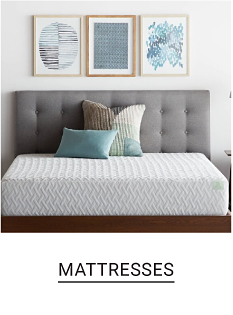 A thick white mattress adorned with two pillows, in front a gray headboard. Mattresses.