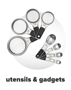 Stainless steel measuring cups and measuring spoons. Utensils and gadgets.