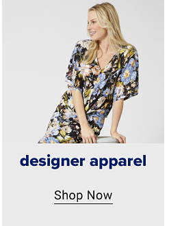 A woman in a floral dress. Designer apparel. Shop now.