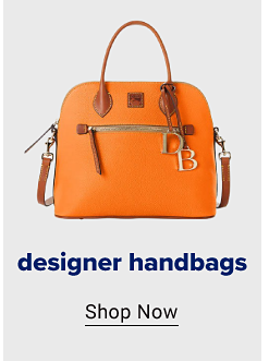 An orange tote bag with brown accents and a gold DB charm hanging off. Designer handbags. Shop now.