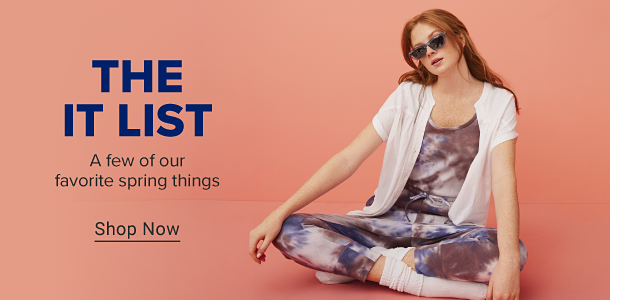 A girl in grey sunglasses, a purple, blue and white tie dye jumpsuit, a white button down and tall white socks. The It List. A few of our favorite spring things. Shop now.