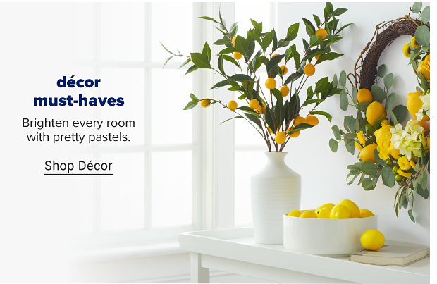 A white bowl full of lemons. A white vase with greenery and yellow. A springtime wreath with flowers and lemons. Decor must haves. Brighten every room with pretty pastels. Shop decor