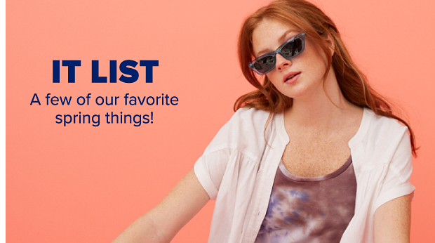 A woman wearing a tie dye jumpsuit with a white cardigan and sunglasses. It List. A few of our favorite spring things.