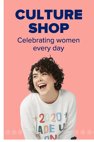A woman wearing a white sweatshirt that says 2020 Made Us Stronger. Culture Shop. Celebrating women every day.