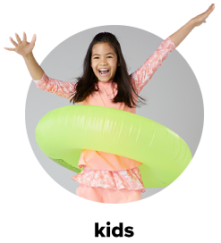 A young girl wearing a peach-colored, two-piece swimsuit carries a neon green float around her waist. Kids.