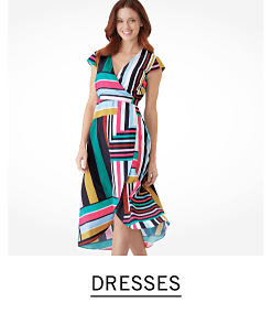 ee65c28c6200 A woman wearing a multi colored striped sleeveless dress. Shop dresses.