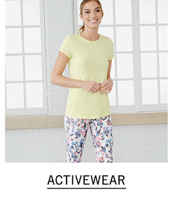 f72e3c62b0c80 A woman wearing a yellow tee and multi colored print pants. Shop activewear.