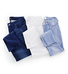 An assortment of folded jeans in a variety of colors. Shop denim.