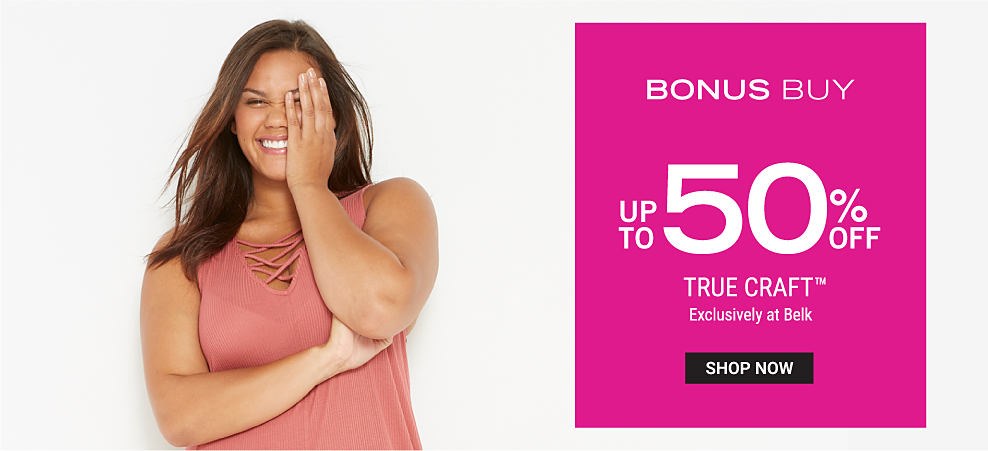 A woman wearing a coral sleevesless dress. Bonus Buy. Up to 50% off True Craft. Exclusively at Belk. Shop now.
