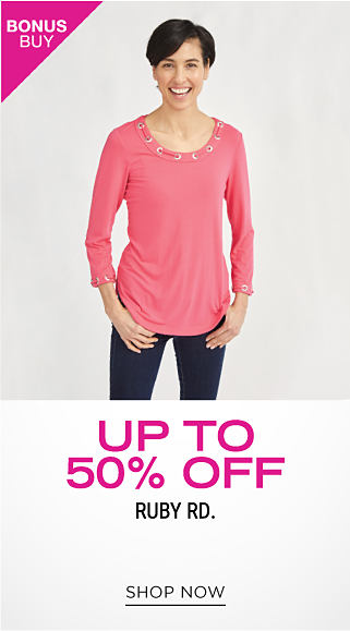 A woman wearing a coral long sleeved top & blue jeans. Bonus Buy. Up to 50% off Ruby Rd. Shop now.