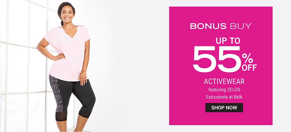 A woman wearing a light pink tee & black yoga pants. Bonus Buy. Up to 55% off activewear featuring Zelos. Exclusively at Belk. Shop now.