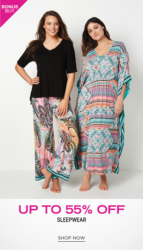 A woman wearing a black long sleeved pajama top & multi colored print pajama bottoms. A woman wearing a multi colored print nightgown. Bonus Buy. Up to 55% off sleepwear. Shop now.