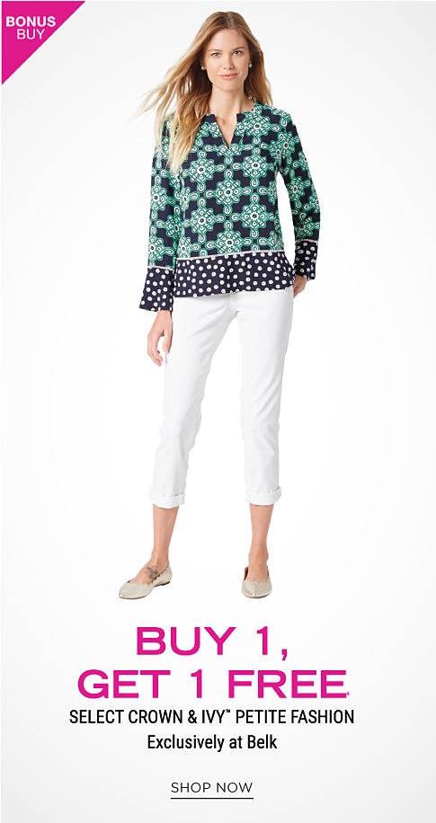 A woman wearing a mint green, navy & white patterned print long sleeved top, white capris & flats. Bonus Buy. Buy 1, Get 1 Free Crown & Ivy petite fashion. Exclusively at Belk. Free item must be of equal or lesser value. Shop now.