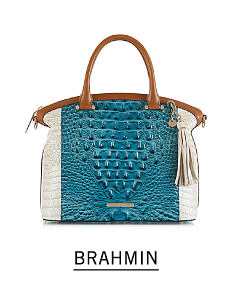 A teal & white croco leather colorblock handbag with brown handles & trim.