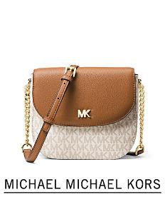 8d8e8c887633 A brown & white leather colorblock handbag. Shop Michael Michael Kors.