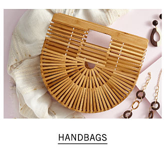 An elaborately constructed bamboo handbag. Shop handbags.