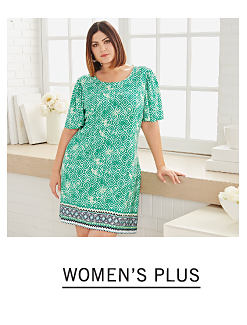 A woman wearing a mint green short sleeved dress with a multi colored print. Shop women's plus.