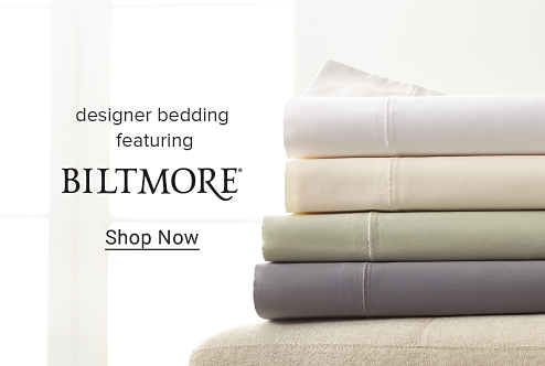 A stack of sheets in white, cream, green and gray. Designer bedding featuring Biltmore. Shop now.