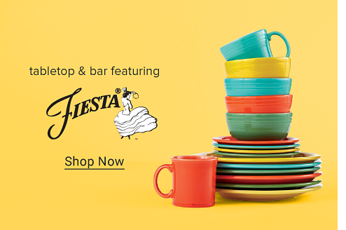 A stack of brightly colored plates, saucers, bowls and mug. Tabletop and bar featuring Fiesta. Shop now. A gif showing brightly colored Fiesta dinnerware added to a blue background, piece by piece.