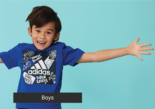 A little boy in a blue Adidas graphic tee. A navy blue icon with basketball. Get ready for playtime. Take themout in cute, sporty styles. Boys.