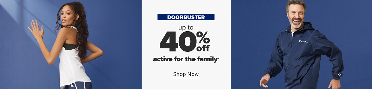 A woman wearing a white tank top and Adidas shorts. A man wearing a navy blue Champion jacket. Doorbuster. Up to 40% off active for the family. Shop now.