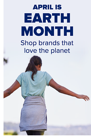 A woman wearing a blue T-shirt and blue sweater around her waist. April is earth month. Shop brands that love the planet.