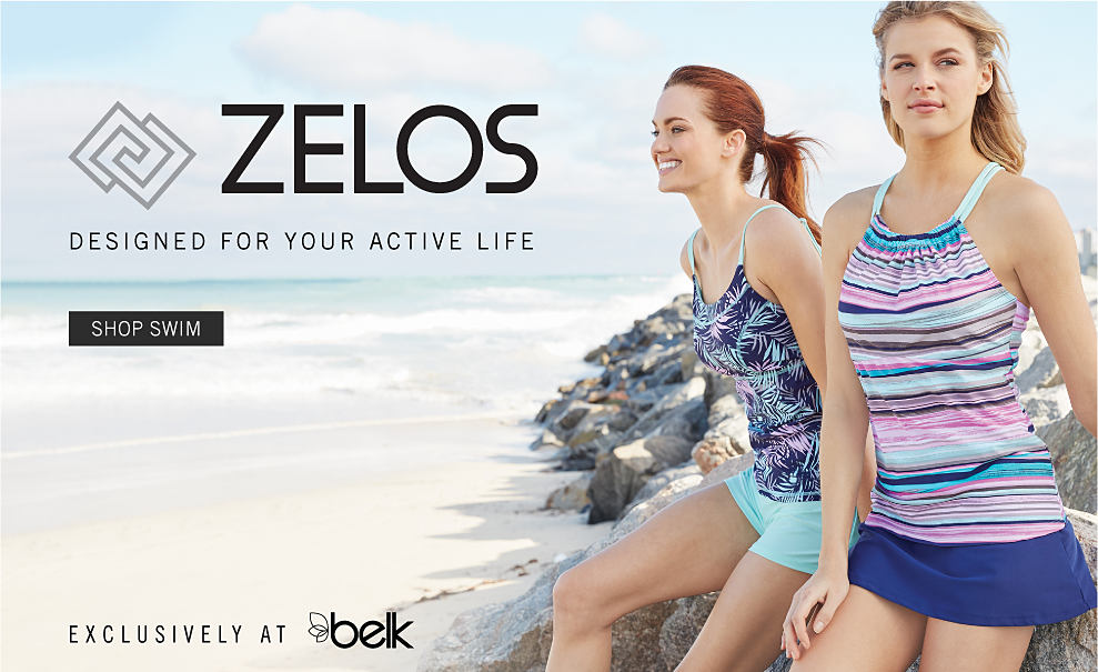 A woman wearing a multi colored print tank top & light blue shorts sitting next to a woman wearing a multi colored horizontal striped tank dress. Zelos. Designed for your active life. Exclusively at Belk. Shop now.