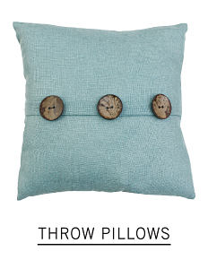 A blue/green throw pillow with three decorative buttons. Shop throw pillows.