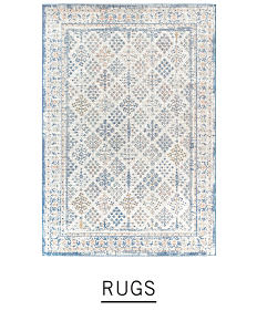 A printed rug in light blue, white and beige. Shop rugs.