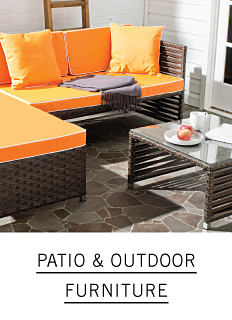 Outdoor furniture with orange cushions. Shop patio and outdoor furniture.