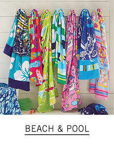 A variety of colorful beach towels. Shop beach and pool.