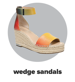 A wedge sandal with a hemp platform base and yellow, pink and green accents on the straps. Wedge sandals.
