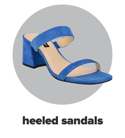 A bright blue sandal with a high heel and two straps. Heeled sandals.