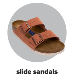 A slide sandal with brown leather straps and buckles. Slide sandals.